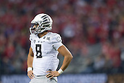 Marcus Mariota #8 of the Oregon Ducks looks on against the Ohio State Buckeyes during the College Football Playoff National Championship Game at AT&T Stadium on January 12, 2015 in Arlington, Texas.  (Cooper Neill for The New York Times)