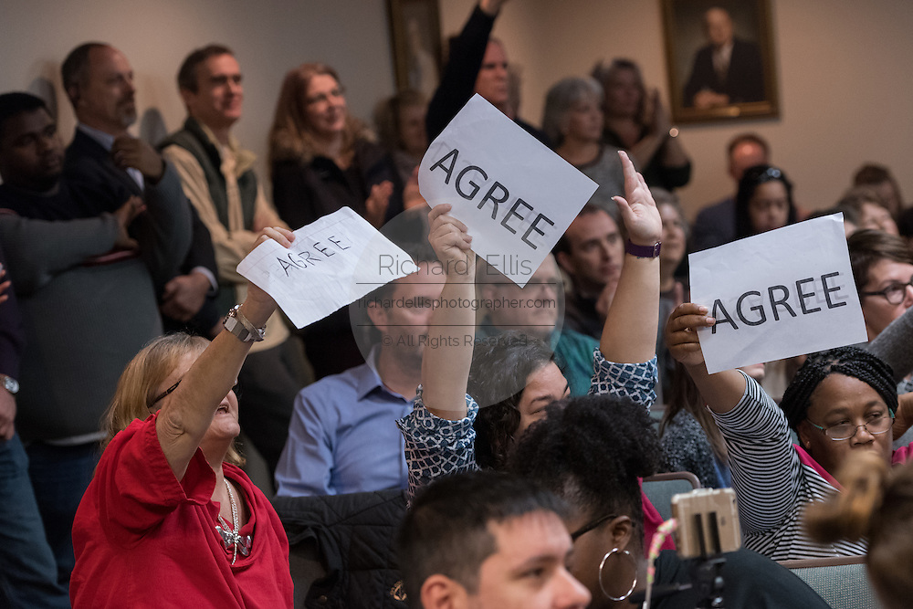 Constituents hold up signs agreeing with a question during a heated town hall meeting with U.S. Sen. Tim Scott and U.S. Rep. Mark Sanford February 18, 2017 in Mount Pleasant, South Carolina. Hundreds of concerned residents turned up for the meeting to address their opposition to President Donald Trump during a vocal meeting held by U.S. Rep. Mark Sanford and Senator Tim Scott.
