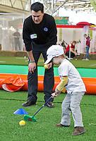 AMSTERDAM - Jong met Inder van Weerelt. Amsterdam Golf Show 2012 in de Amsterdamse Rai. Foto Koen Suyk