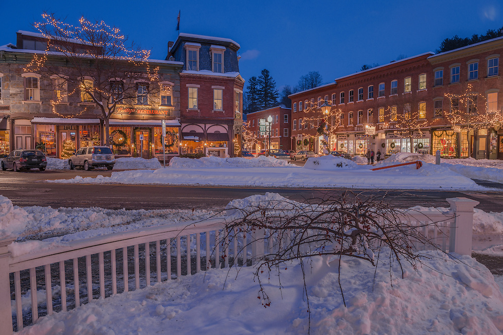 Downtown Woodstock at dusk with snow & Christmas lights aglow in winter, Woodstock, VT