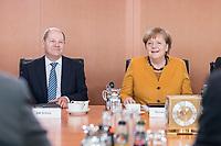 27 FEB 2019, BERLIN/GERMANY:<br /> Olaf Scholz (L), SPD, Bundesfinanzminister, und Angela Merkel (R), CDU, Bundeskanzlerin, vor Beginn der Kabinettsitzung, Bundeskanzleramt<br /> IMAGE: 20190227-01-025<br /> KEYWORDS: Kabinett, Sitzung