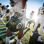 Josh Eubanks (holding helmet) and James Durpee (13) watch the final plays of their game against Santa Ana College on November 8, 2014 in Santa Ana Stadium in Santa Ana, CA. Fullerton defeated Santa Ana 30-23.