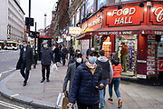 As Londoners await the announcement of a second coronavirus lockdown it's business as usual in Soho in the West End with people out and about on what will be the last weekend before a month-long total lockdown in the UK on 30th October 2020 in London, United Kingdom. The three tier system in the UK has not worked sufficiently, to suppress the virus, and there have have been calls by politicians for a 'circuit breaker' complete lockdown to be announced to help the growing spread of the Covid-19.