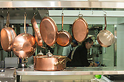 Copper pots and pans in a restaurant kitchen