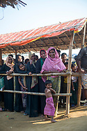 Rohingya women and children wait in line for a humanitarian aid distribution at Jamtoli refugee camp in Bangladesh. (October 26, 2017)