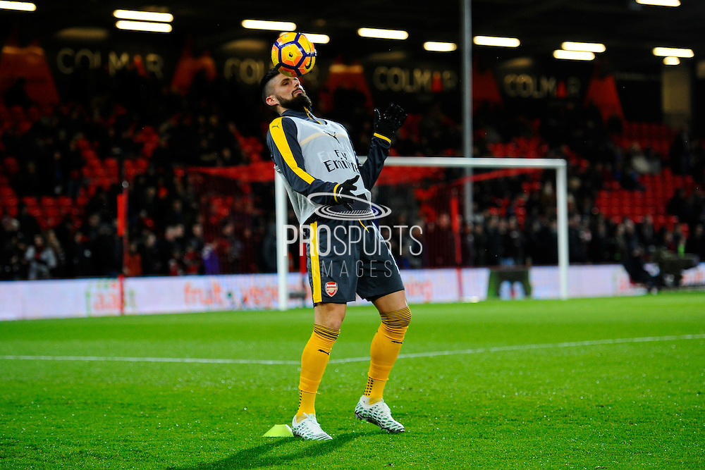 Olivier Giroud (12) of Arsenal with the ball on his head while warming up before the Premier League match between Bournemouth and Arsenal at the Vitality Stadium, Bournemouth, England on 3 January 2017. Photo by Graham Hunt.