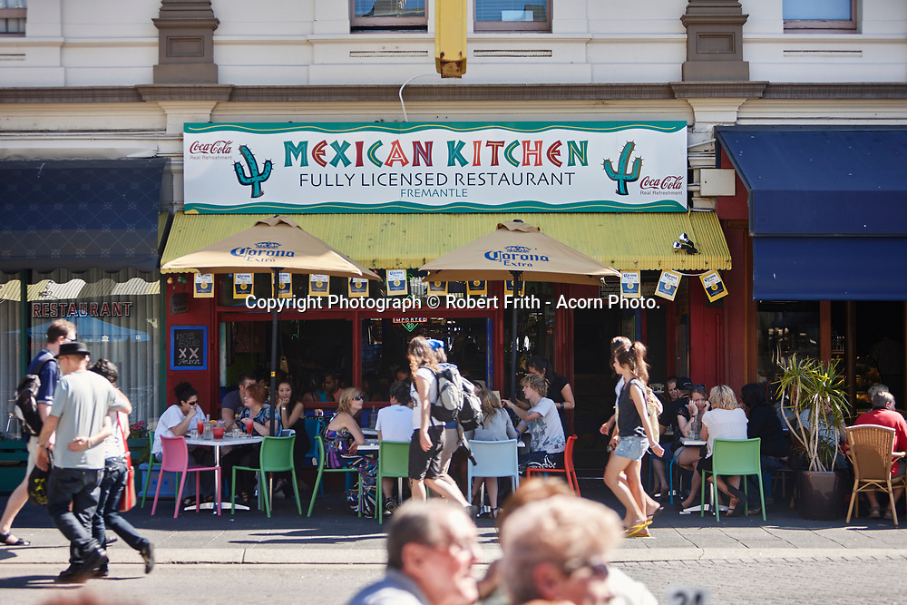 Sunday morning on the Fremantle Café Strip, South Terrace. People walking past the Mexican Kitchen