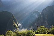 Sun rays seen in early morning over the mountains surrounding Machu Picchu, Cusco Region, Urubamba Province, Machupicchu District in Peru, South America