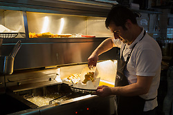 Chef Eddie Macit plates up a meal at London's first totally vegan chippy in Hackney, North East London. Hackney, London, October 08 2018.
