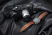 luxury-lifestyle-photos-by-photographer-randy-wells, Image of a Leica M4-2 rangefinder camera with a 50mm lens and an Omega Speedmaster wristwatch