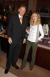 RICHARD & BASIA BRIGGS at a party to celebrate 100 years of Chinese Cinema hosted by Shangri-la Hotels and Tartan Films at Asprey, New Bond Street, London on 25th April 2006.<br />
