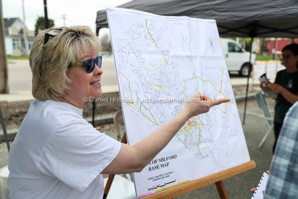 (4/29/17, MILFORD, MA) Volunteer Geri Eddins helps people pick out locations around town where they can pick up litter during the Third Annual Milford Beautification Day in downtown in Milford on Saturday. [Daily News and Wicked Local Photo/Dan Holmes]