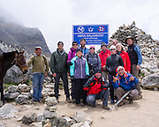 A group of hikers and their guides celebrates their achieving their arrival at Salkantay Pass, along Camino Salkantay, near Soraypampa, Peru.