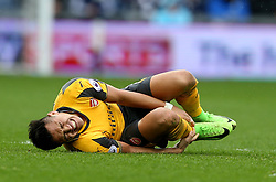 18 March 2017 Premier League Football : West Bromwich Albion v Arsenal :<br /> Alexis Sanchez of Arsenal clutches his injured ankle.<br /> Photo: Mark Leech