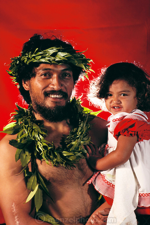 Hawaiian man and child. Hula contest in Hilo, on the Big Island, Hawaii. USA. MODEL RELEASED.