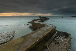 The stone pier at St Monan's on the Fife Coast of the River Forth