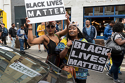 """© Licensed to London News Pictures. 09/07/2016. London, UK. Local residents hold a """"Black Lives Matter"""" rally in Brixton, to show solidarity with those who lost their lives in recent police related incidents in the USA. Photo credit : Stephen Chung/LNP"""