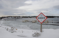 Frigid weather arrived Tuesday along with high winds combined with the warmer than normal temperatures have kept the lake from freezing as seen from Watermark Construction on Paugus Bay.    (Karen Bobotas/for the Laconia Daily Sun)