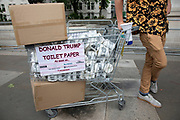 Donald Trump toilet paper for sale during protests against the state visit of US President Donald Trump on 4th June 2019 in London, United Kingdom. Organisers Together Against Trump which is a collaboration between the Stop Trump Coalition and Stand Up To Trump, have organised a carnival of resistance, a national demonstration to protest against President Trump's policies and politics during his official UK visit.