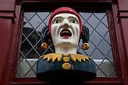 Jester figurehead outside Van der Gaag Pharmacy, The Hague, The Netherlands, in business since 1776.
