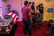 Family members of deported U.S. Army veteran Jose Raúl López Jiménez, 52, gather during a private family viewing at a funeral home a day before his burial in Hobbs, New Mexico, Friday, Oct. 4, 2019.<br /> <br /> López had been shot in the head in his own home in Chihuahua, Chihuahua, México a few weeks prior on September 14th. A gunman, who has not been identified, had broken into his home and shot López along with two other men, one of which died at the scene and the other survived after a gunshot to his arm. His family in the United States, including his mother and some of his brothers, had made their way to Chihuahua after hearing the news regarding the incident. After authorities had checked the home as part of a crime scene, López's brothers had to clean up the aftermath including blood that remained on the floors.<br /> <br /> López was hospitalized for nearly two weeks and was responsive to his mother and brothers that came to visit him during his recovery. On September 27, 2019, López was left unattended for two hours and a woman had entered his room and then left after a short period of time according to his family. He died shortly after that same day and the woman was never able to be identified giving the family suspicion of foul play in López's death.
