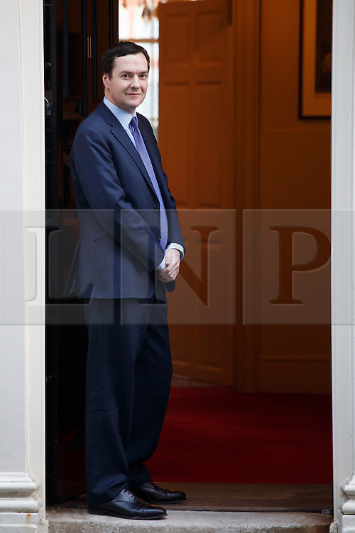 © licensed to London News Pictures. London, UK 04/02/2014. Chancellor of the Exchequer George Osborne waiting for The International Monetary Fund (IMF) Managing Director Christine Lagarde outside Number 11 in Downing Street on Tuesday, 04 February 2014. Photo credit: Tolga Akmen/LNP
