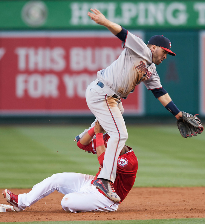 The Angels' Gregorio Petit is out at second as Twins second baseman Brian Dozier turns a double play in the second inning Tuesday night at Angel Stadium.<br /> <br /> ///ADDITIONAL INFO:   <br /> <br /> angels.0615.kjs  ---  Photo by KEVIN SULLIVAN / Orange County Register  -- 6/14/16<br /> <br /> The Los Angeles Angels take on the Minnesota Twins Tuesday at Angel Stadium.