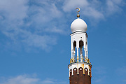 Birmingham Central Mosque minaret tower in Highgate, on 3rd August 2020 in Birmingham, United Kingdom. Birmingham Central Mosque is one of the earliest purpose-built mosques in the UK, and is run by the Birmingham Mosque Trust. The organization, Muslims in Britain classify the Birmingham Central Mosque as, hanafi sunni, and has a capacity of 6,000, including women.