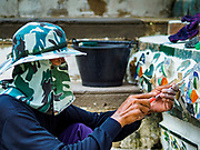 """11 SEPTEMBER 2017 - BANGKOK, THAILAND: Workers finishing up the renovation of Wat Arun. Renovations are nearly finished at Wat Arun on the Thonburi side of the Chao Phraya River in Bangkok. Wat Arun is famous for its Khmer style main """"prang"""" (chedi). It was originally built in the Ayutthaya Period and rebuilt to its current form in the time of Rama II.      PHOTO BY JACK KURTZ"""