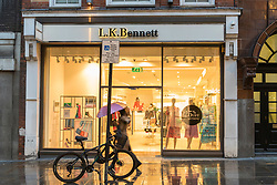 © Licensed to London News Pictures. 07/03/2019. LONDON, UK.  A woman walks by the LK Bennett store in Covent Garden.  LK Bennett, a chain of high-end women's clothing stores, has announced that it has called in EY as administrators after being unable to secure financing.  The brand is reported to be a favourite of the Duchess of Cambridge.  Photo credit: Stephen Chung/LNP