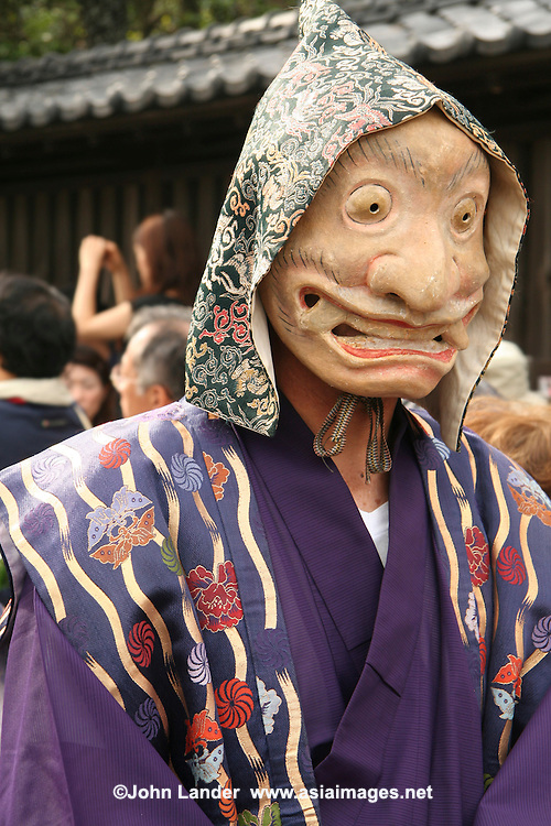 Mengake Mask Procession - Mengake or Masked Parade at Goryo Jinja shrine.  At this festival a group of ten people take part in this annual ritual: 8 men and 2 women. Wearing grotesque or comical masks  leave the shrine and parade through the nearby streets accompanied by portable shrine and festival music.