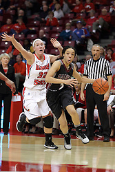 04 January 2015:  Blair Stephenson heads towards the paint beating out defender Taylor Stewart during an NCAA MVC (Missouri Valley Conference) women's basketball game between the Southern Illinois Salukis and the Illinois Sate Redbirds at Redbird Arena in Normal IL
