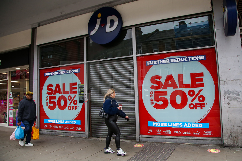 © Licensed to London News Pictures. 19/02/2021. London, UK. Shoppers walk past closed retail businesses in Wood Green, north London. According to the Office for National Statistics (ONS), in January 2021, retail sales decreased by 8.2%, compared with December 2020. Tighter nationwide coronavirus (COVID-19) restrictions on non-essential retailers which forced them to close led to the drop in January's retail sales. Departmental and clothing store sales were particularly affected. Photo credit: Dinendra Haria/LNP