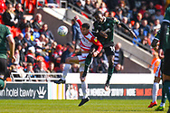 Freddie Ladapo of Plymouth Argyle (19) and Matty Blair of Doncaster Rovers (17) in action during the EFL Sky Bet League 1 match between Doncaster Rovers and Plymouth Argyle at the Keepmoat Stadium, Doncaster, England on 13 April 2019.