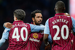 Christian Benteke of Aston Villa celebrates scoring a goal to make it 1-1 with Jack Grealish (making his first Premier League start) and Kieran Richardson - Photo mandatory by-line: Rogan Thomson/JMP - 07966 386802 - 07/04/2015 - SPORT - FOOTBALL - Birmingham, England - Villa Park - Aston Villa v Queens Park Rangers - Barclays Premier League.