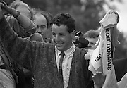 Stephen Roche, Tour de France Winner.  (R61)..1987..26/27 .07.1987..07. 26/27.1987..26/27th July 1987..Tour de France Winner Stephen Roche, the first Irishman to do so , was feted on his arrival back in Dublin. The people of Ireland descended on Dublin to throng the streets as they congratulated Stephen on his momentous achievement...Portrait of a very happy Stephen Roche waving to the crowds as he is paraded through the streets of Dublin.