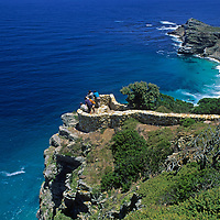 Tourists overlook the Cape of Good Hope at the southern tip of Africa, where the Atlantic and Indian Oceans meet.