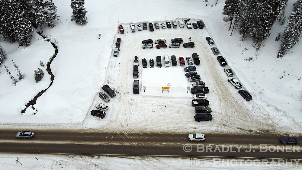 The Coal Creek parking lot at the base of the west side of Teton Pass, seen here on New Year's Eve, was at or near capacity several times over the holidays.