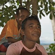 Papuan kids hanging out in the shade.