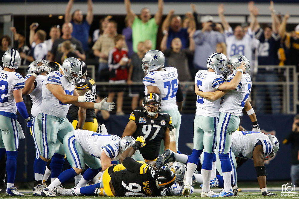 Dallas Cowboys kicker Dan Bailey (5) and Dallas Cowboys punter Brian Moorman (2) celebrate after Bailey kicks the game winning field goal against the Pittsburgh Steelers in overtime, 27-24, at Cowboys Stadium in Arlington, Texas, on December 16, 2012.  (Stan Olszewski/The Dallas Morning News)