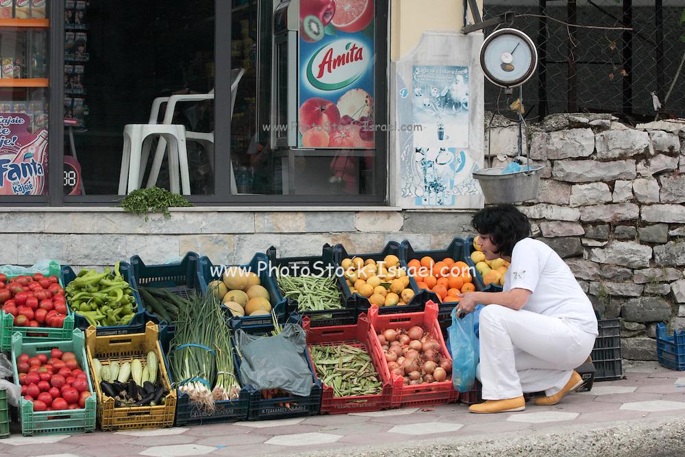 Albania Labova, Woman buying vegetables