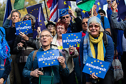 © Licensed to London News Pictures. 20/10/2018. London, UK. Demonstrators Melinda Rickett, Becky Brook and Lucy Rickett take part in the 'People's Vote' march in central London, campaigning for a public vote on the final Brexit deal. Organisers are expecting over 100,000 to attend the demonstration. Photo credit : Tom Nicholson/LNP