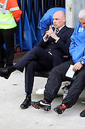 Wigan Athletic's Manager Uwe Rosler takes his seat in dugout prior to the game. Skybet football league championship play off semi final, 1st leg match, Wigan Athletic v QPR at the DW Stadium in Wigan, England on Friday 9th May 2014.pic by Chris Stading, Andrew Orchard sports photography.