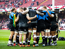 England forwards huddle during the pre match warm up<br /> <br /> Photographer Simon King/Replay Images<br /> <br /> Six Nations Round 3 - Wales v England - Saturday 23rd February 2019 - Principality Stadium - Cardiff<br /> <br /> World Copyright © Replay Images . All rights reserved. info@replayimages.co.uk - http://replayimages.co.uk