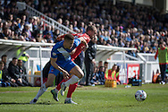 Hartlepool United defender Jake Carroll and Luke Summerfield of York City FC (8) battle for the ball during  the Sky Bet League 2 match between Hartlepool United and York City at Victoria Park, Hartlepool, England on 16 April 2016. Photo by George Ledger.