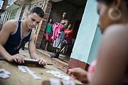 Domino match. Trinidad, Cuba. February / 2014.
