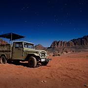 Old 4WD jeep in desert at night, Wadi Rum, Jordan (December 2007)
