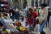 London, UK 6th December 2013: People gather in Parliament Square to lay flowers and pay tribute at the statue to former South African leader and anti-apartheid ANC campaigner Nelson Mandela, who died aged 95 on 5th December 2013.