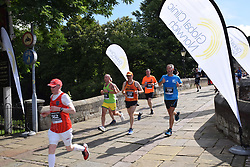 Norwich UK. 6th August 2017. 4700 people took part in the annual Run Norwich 10k road race organised by Norwich City FC Community Sports Foundation. Running over Bishop's Bridge, the only medieval bridge left in Norwich