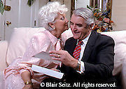 Active Aging Senior Citizens, Retired, Activities, Elderly Exchanging Gifts and Love, Loving as Seniors, A Gift and a Kiss